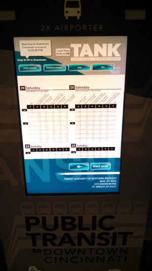 kiosk at the CVG airport in cincinnati showing the time of the next transit bus arrival