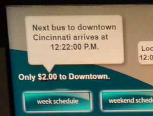 kiosk at cvg airport showing the time of the next bus arriving to take people downtown